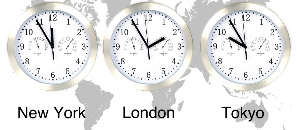 World time zones. Time in London, New York and Tokyo, three clocks against grey world map. Boston Chauffeur international limo & chauffeur service